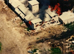 The Branch Davidian property after it was set on fire by tanks.  Attribution: wiki user Carolmooredc