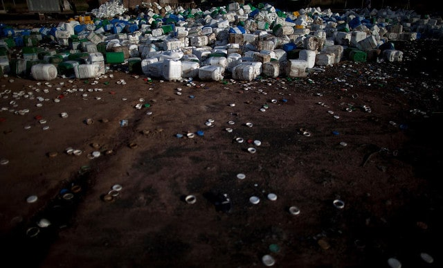 Empty agrochemical containers lay discarded at a recycling center in Quimili, Santiago del Estero province, Argentina, May 2, 2013. CREDIT: Natacha Pisarenko/AP