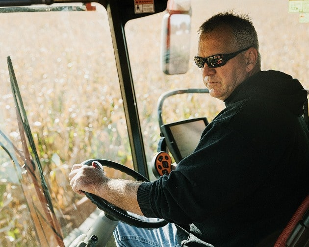 Huegerich, in his combine. He has no ideological problem with GMOs but has been experimenting with conventional seeds for financial reasons.