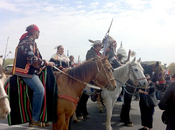 "Tribal leaders mounted on horseback in front of the Capitol Building en route to the ""Reject and Protect"" tipi encampment in Washington, DC."