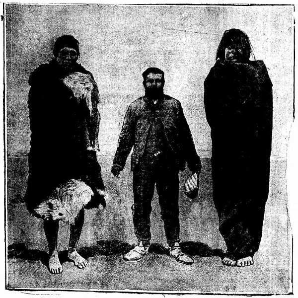 Dr. Cook with two Patagonian giants standing at around 7 ft. tall.